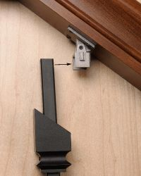 Attach Top Clip Bracket and slide in iron baluster